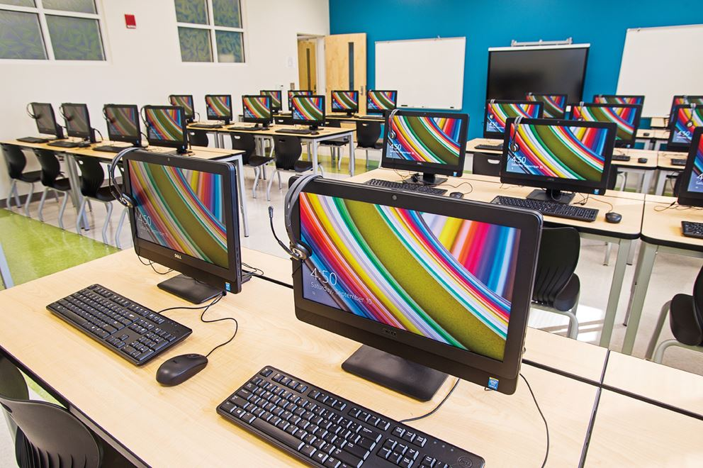 Nexton Elementary's computer classroom full of computers with headphones