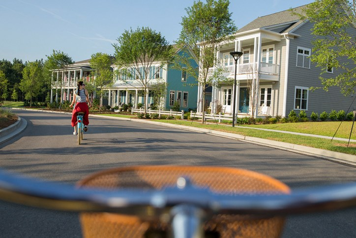 Nexton-Homes-Woman-on-Bicycle.png
