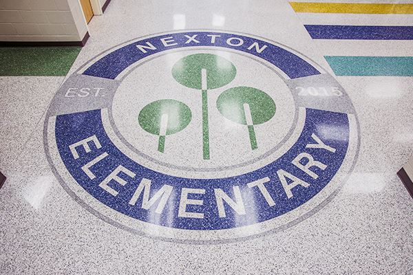Nexton Elementary's logo painted on the floor of the school hallways
