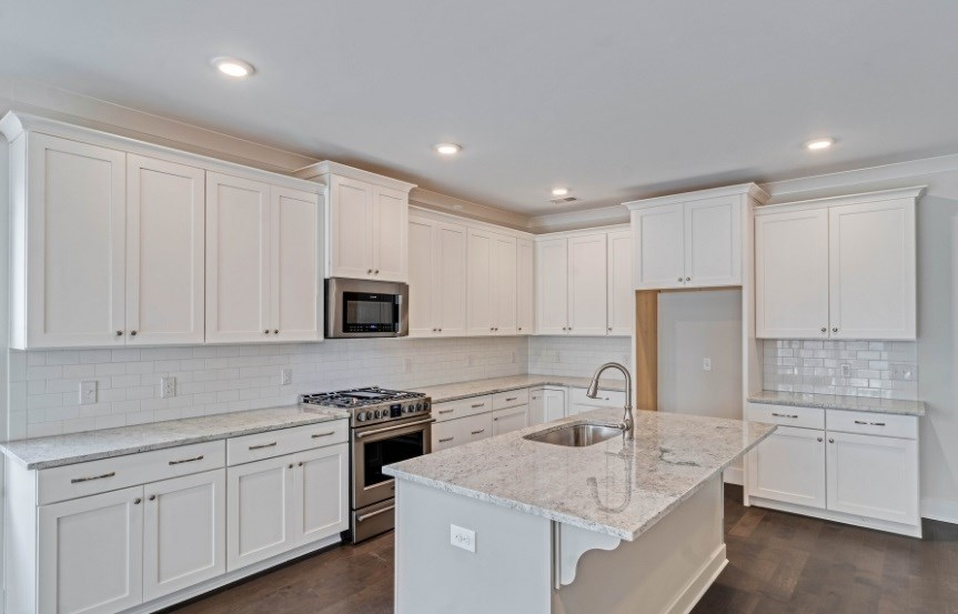 Homes By Dickerson move-in ready home kitchen cabinets and island