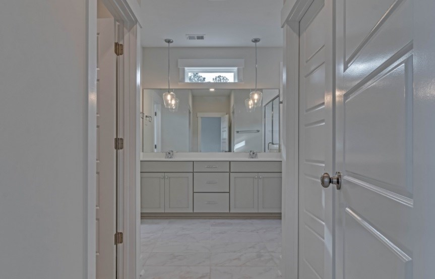 Homes By Dickerson move-in ready home master bath entryway