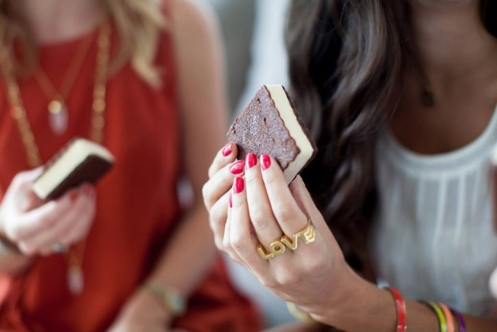 Woman enjoying ice cream sandwich