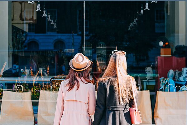 Women window shopping in Nexton Square.