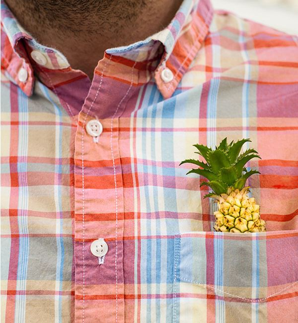 Pineapple in shirt pocket, part of Midtown Nexton identity.
